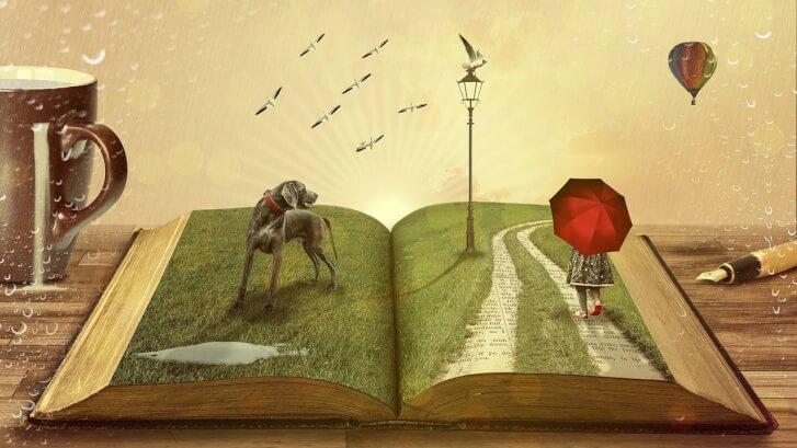 Otwarta książka, z której wyrasta trawa, park, spacerowiczka i zwierzęta. Treść czytana zmienia się w wyobrażenie.