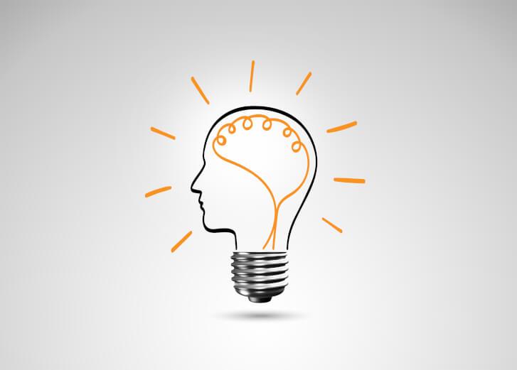Symbol sprawności umysłu. Głowa wpisana w żarówkę, emanuje światłem.